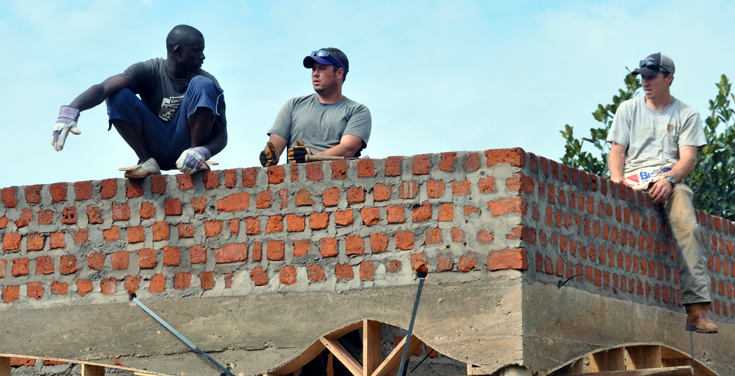 Team members help construct ACA in Uganda